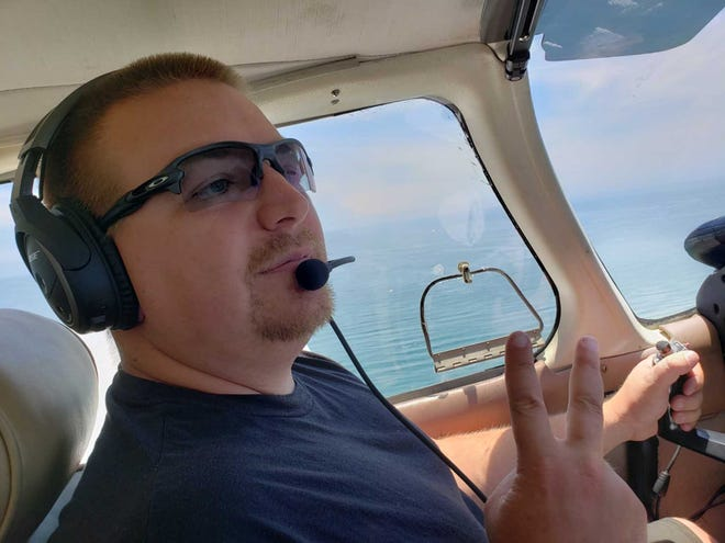 Josh Arnold at the controls of a Piper Archer during his pilot training at Tradewinds Flight Services.
