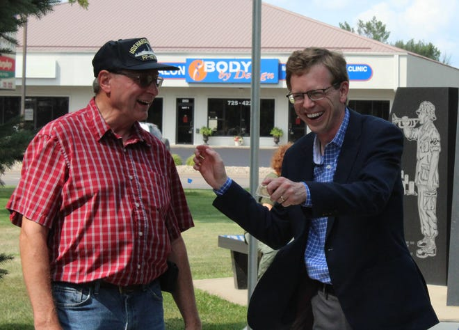 Before heading out to the Brown County Fair Thursday, U.S. Rep. Dusty Johnson, R-S.D., presented commemorative pins to area Vietnam-era veterans at Anderson Park. In this image, he enjoys a smile with one of the veterans, Rick Hagmann. Other veterans or family members who received pins included David Gonsor, Larry Lewis, Chuck Blumhardt, Neill Wagner, Harlod Kempf, Robert Zimmerman, Monte Likness, Cliff Kranzler, Rodney Barr, Don Lout, David Rogers, Lanny Wahl, Skip Clay, Ron Hoffer, Larry Kruger, Robert Weishaar and Jason Goette.