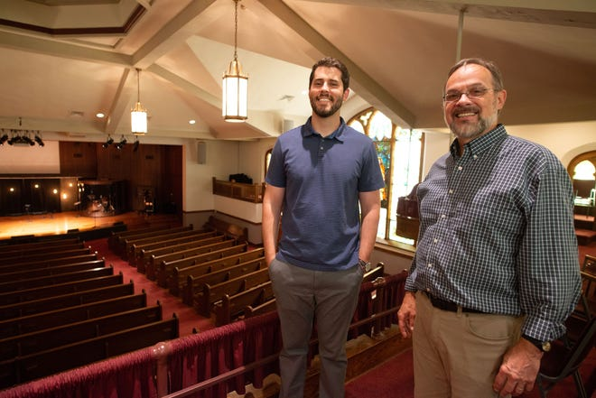 Connor Kraus, left, stands alongside Jim Congdon inside Topeka Bible Church.  After more than 40 years, Congdon will step into a new position within the church. Kraus will become lead pastor.