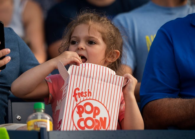 A young fan chows down on popcorn during a WooSox game against Scranton earlier this season.