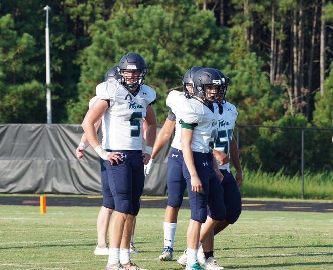 Senior Leesville Road edge rusher Beau Atkinson (5) scrimmages against Clayton at Rolesville High School's 2021 Ram Jam on Aug. 13, 2021. Atkinson, a four-star recruit and the No. 7 player in North Carolina's class of 2022 per 247Sports composite rankings, verbally committed to UNC over Miami and Michigan in June.