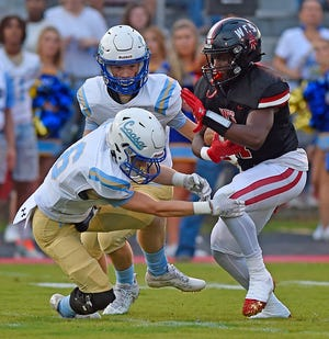 Westbrook's Karmichael Cattling tries to evade the tackle of Coosa's Dylan Edwards during high school football action on Aug. 19, 2021, in Rainbow City.