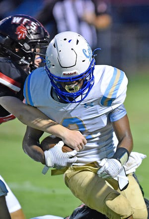 D.J. Smith, seen carrying the ball against Westbrook Christian on Aug. 19, and Coosa Christian improved to 2-1 on the season with a 49-0 rout of Woodville on Friday.