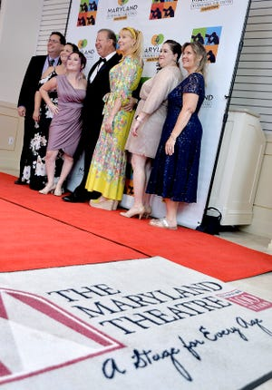 Filmmakers gather for a photo on the red carpet during the opening night of the Maryland International Film Festival on Friday at The Maryland Theatre in Hagerstown.