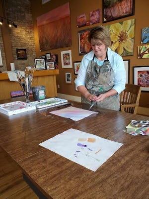 Sandy Ellyson works Saturday in her business and studio called Century Gallery.