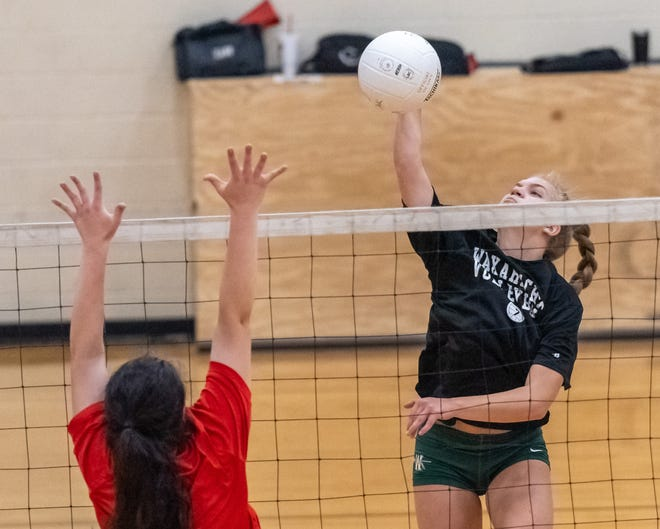 Waxahachie's Amber Morgan goes for the kill during a preseason scrimmage against Red Oak.
