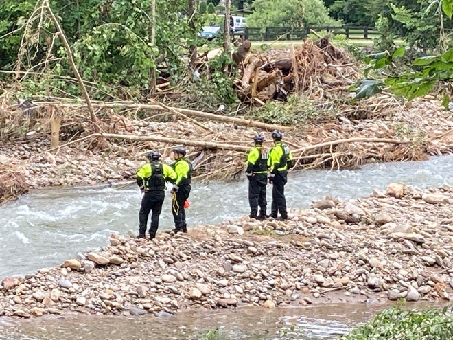 Search and rescue teams have picked through nearby massive debris piles near the river in Cruso on Aug. 20.