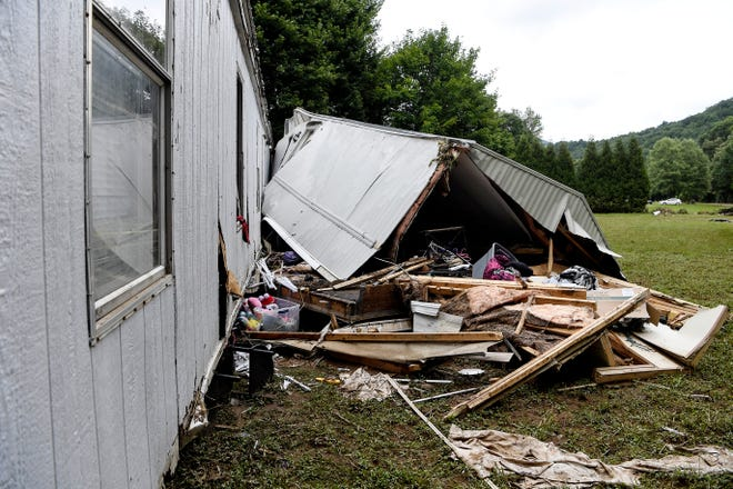 Amanda and Dorian Lynn's home was destroyed as it was washed away by a flooded Pigeon River.