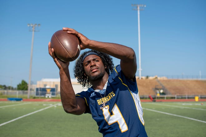 Battle Creek Central's Kylon Wilson (4) poses for a photograph on Friday, Aug. 20, 2021 at Battle Creek High School.