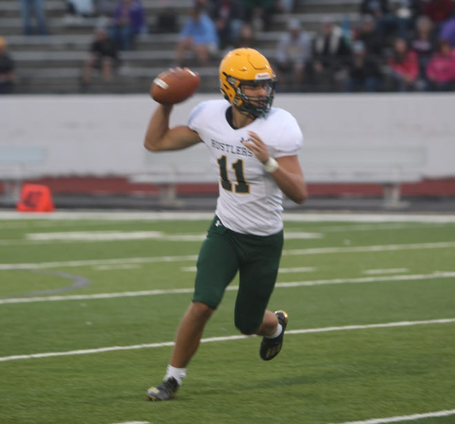 CMR quarterback Cole Taylor scrambles to the near side during the Rustlers' scrimmage Thursday, August 19 at Memorial Stadium.