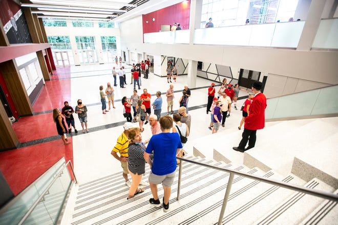 People tour during a ribbon cutting ceremony for the new addition, Friday, Aug. 20, 2021, at City High School in Iowa City, Iowa.