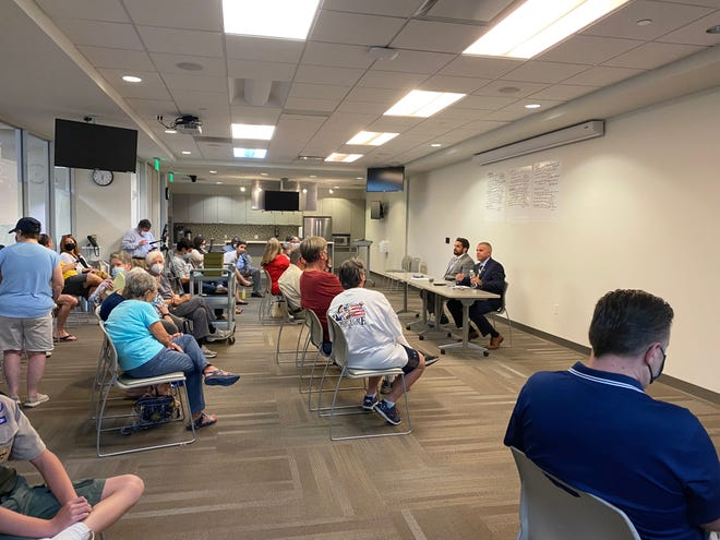 Jackson City Mayor Scott Conger and Jackson POlice Chief Julian Wiser answer community member's questions at a Lambuth Area Neighborhood Association meeting Thursday night at The LIFT.