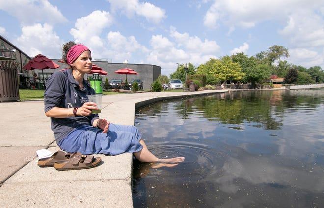 Ellen Smith of Brighton enjoys a peaceful view of Brighton's Mill Pond Thursday, Aug. 19, 2021.