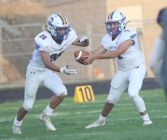 Ontario's Drew Yetter (26) ran for 146 yards on 11 carries with a pair of touchdowns in the Warriors' 49-19 win over Hebron Lakewood.