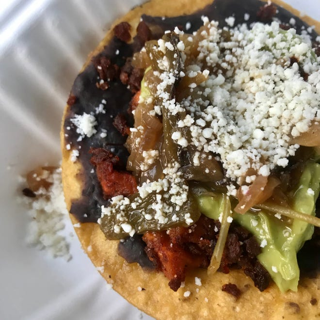 A soy chorizo tostada with sweet potato, guacamole, cotija cheese and citrus rajas, atop refried black beans. It's one of four tostadas that the new food trailer Tostada by Maranta sells, along with chicken, pork belly and mushroom tostadas.