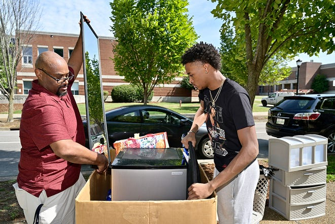 Jarrold Tatum, left, places a mirror into a large box and son Justin Tatum adds another item during the new MTSU students' move-in day at Corlew Hall on Wednesday, Aug. 18. Students will be moving into campus housing during designated times through Saturday afternoon. Nearly 3,000 students will be in university housing this fall.