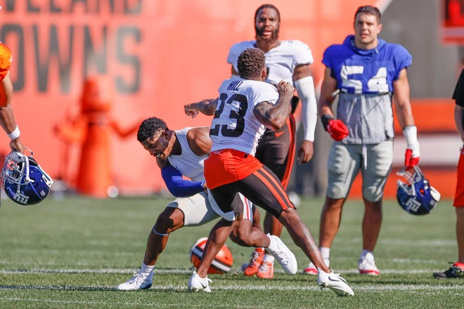CBrowns cornerback Troy Hill (23) and New York Giants wide receiver Sterling Shepard (3) get into a fight after a joint training camp practice Friday in Berea. [Ron Schwane/Associated Press]