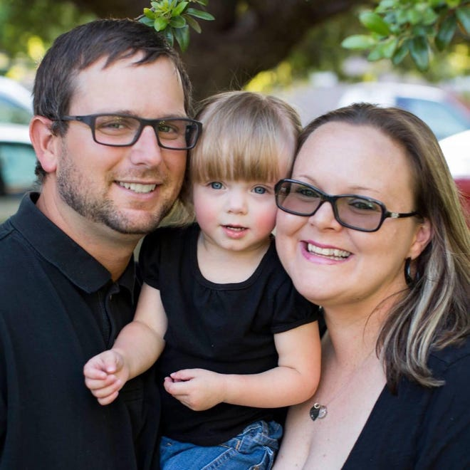 Niki Lawson with her daughter and husband.
