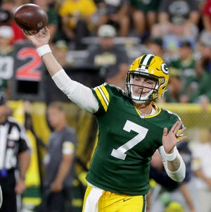 Green Bay Packers quarterback Kurt Benkert (7) throws  during their preseason game against Houston last Saturday at Lambeau Field.  MARK HOFFMAN/MILWAUKEE JOURNAL SENTINEL