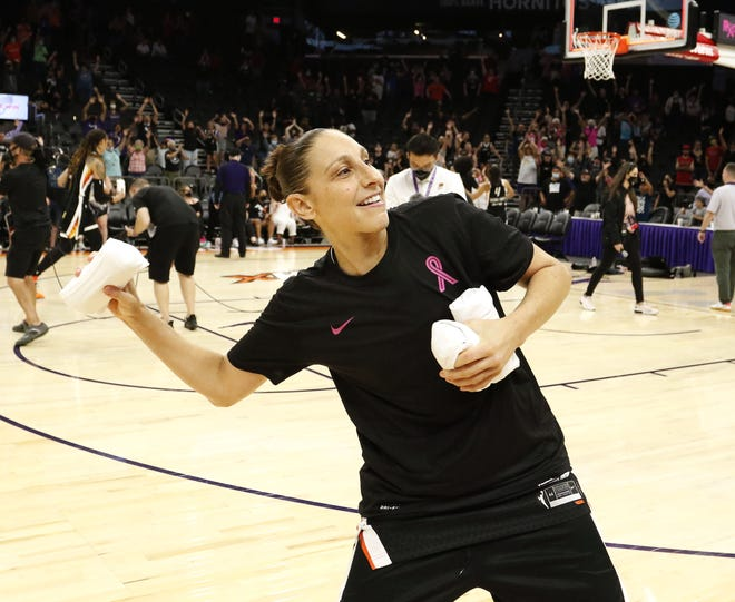 After their win over the Washington Mystics, Phoenix Mercury's Diana Taurasi throws t-shirts to fans at the end of their game at Footprint Center Aug, 19, 2021 in Phoenix.