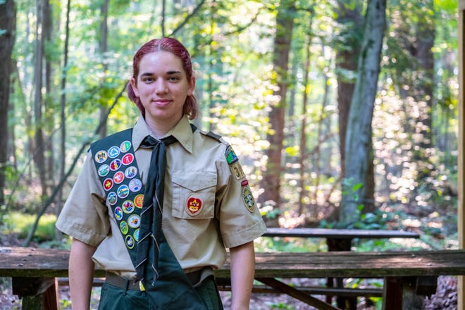 Emma Zobl, 18, poses for a portrait under the pavilion she constructed as part of her Eagle Scout project Friday, Aug. 20, 2021, at Camp Otsiketa in St. Clair. Zobl is the first female Eagle Scout in the Blue Water District.