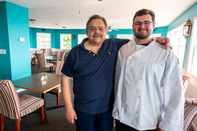 """Tasis """"Tasso"""" Cardaris, left, and his son John pose for a portrait Friday, Aug. 20, 2021, at The View Waterfront Restaurant in Port Sanilac."""