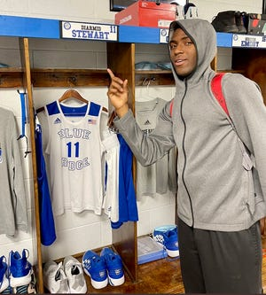 Former Spring Grove High basketball player Diarmid-Nahshon Stewart poses in front of his new locker. Stewart announced Friday he has transferred to Blue Ridge School in Virginia.