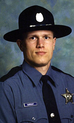 Oregon State Police Sgt. John Burright was critically injured Sept. 4, 2001 when a drowsy driver struck him and two other officers who had stopped to assist a disabled van alongside Interstate 5 south of Salem. Burright died of complications from those injuries on May 4, 2021.