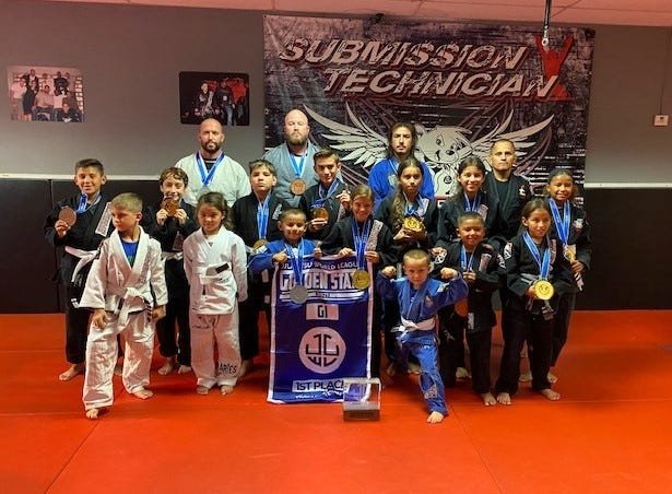 The Brazilian Jiu Jitsu youth team Speedy BJJ, of Tulare, placed first in the Golden State Cup on Aug. 14, 2021 in Stockton. The team includes, top row, left to right: Dustan Wheeler (2nd), Kyle Rening (3rd), Adam Martinez (2nd), Jesus Gonzalez (coach); middle row, left to right: Raul Meraz III (3rd), Roman Solez (1st), Jared Torres (1st), Dylan Costa (1st), Jasmin Gonzalez(1st), Marisa Gonzalez (3rd), Rio Rening (1st); bottom row, left to right: Dustan Wheeler, Emma Boss (1st), Jesus Gonzalez (2nd), Hayden Ormonde (1st), Hunter Ormonde (4th), Bishop Rening (3rd), Marisela Gonzalez (1st). Not Pictured: Mason Ortiz (4th).