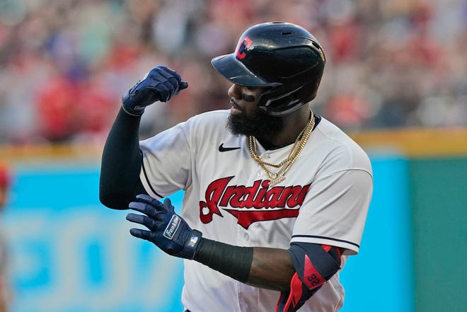 Cleveland designated hitter Franmil Reyes points to his muscles as he rounds the bases after hitting a three-run home run in the first inning of a 9-1 win over the Los Angeles Angels on Friday at Progressive Field. [Tony Dejak/Associated Press]