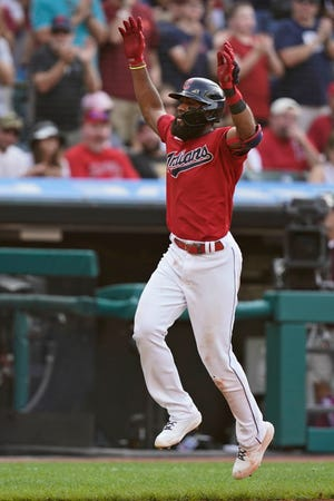 Cleveland's Amed Rosario celebrates after hitting a solo home run in the seventh inning of a baseball game against the Los Angeles Angels, Saturday, Aug. 21, 2021, in Cleveland. (AP Photo/Tony Dejak)