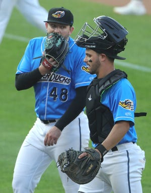 RubberDucks pitcher Konnor Pilkington talks with catcher Bryan Lavistada during one of his first starts since coming over in a trade with the Chicago White Sox. [Phil Masturzo/ Beacon Journal]