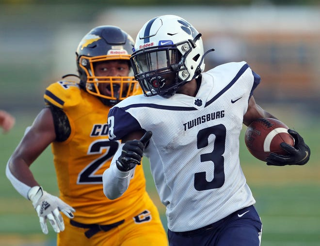 Twinsburg wide receiver Steve Cammack runs for yards after a catch against Copley earlier this season. [Jeff Lange/Beacon Journal]