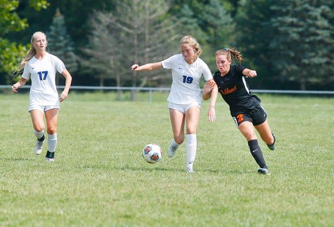 Ashland High School's Ella Plank (2) and Anthony Wayne High School's Sophia Schneider (19) battle for the ball Saturday, Aug. 21, 2021.