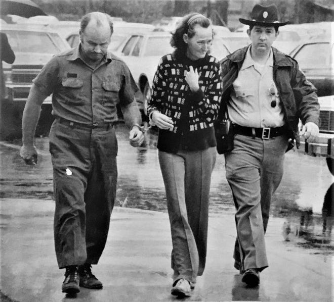 A deputy leads John Henry Owens and his wife, Nellie Pearl, to court in 1981.