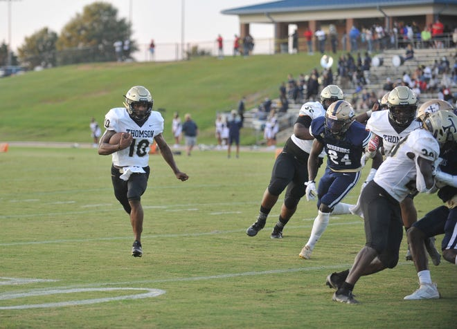 Tay Martin runs during a game Friday night at Jefferson County on Aug. 20, 2021. [WYNSTON WILCOX/THE AUGUSTA CHRONICLE]