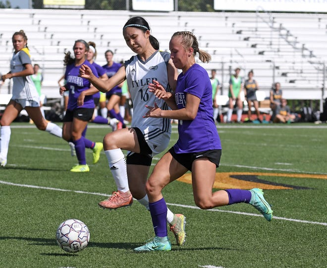 Butler freshman forward Kenzee Godwin (right) and Tyler defender Emmy Dodson battle for possession during the first half of the Grizzlies' season opener on Friday afternoon at BG Products Veterans Sports Complex. Butler, ranked 11th in the NJCAA preseason poll, allowed a pair of second-half goals in a 2-0 loss to the top-ranked Apaches.