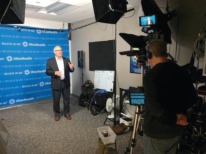 Dr. Steve Markovich, CEO of OhioHealth, filming one of his regular updates for staff during the early days of the coronavirus pandemic.