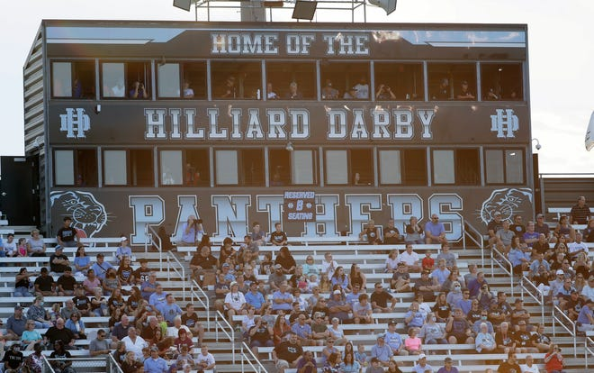 Hilliard Darby fans watch as their team takes on Olentangy Orange during the first game of the season at Hilliard Darby High School on August 20, 2021.