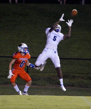 Asheboro's Hakemme Butler gets set to haul in a pass in what turned out to be a 27-yard touchdown against Randleman in the Blue Comets' 20-7 win. [Mike Duprez/Courier-Tribune]