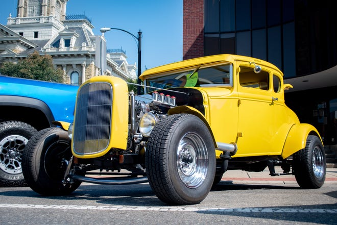 A 1930's yellow Ford, owned by Rick Gallagher, sits on Wheeling Avenue during the Cruise-In.