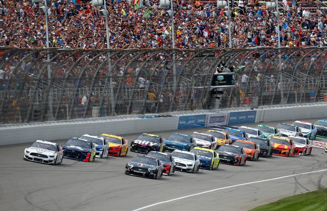 Michigan native Brad Keselowski (Rochester Hills) and Kevin Harvick, right front, lead the field during a NASCAR Cup Series race at Michigan International Speedway on Sunday, Aug. 11, 2019. (AP Photo/Paul Sancya)