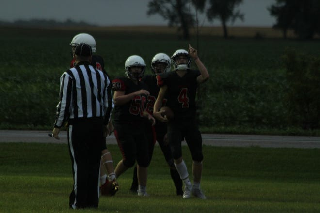 Garrett Westland (4) celebrates after scoring one of his four touchdowns against the Dunseith Dragons Aug. 20.