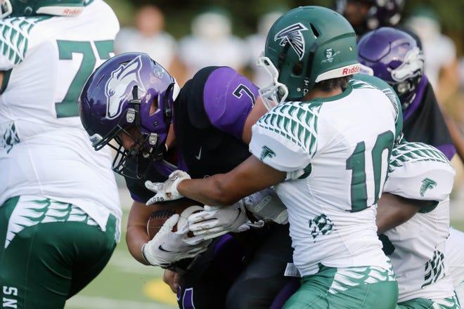 Burlington High School's Nolan Simpson (7) is stopped during a scrimmage against West Burlington-Notre Dame Friday Aug. 20, 2021, at Burlington's Bracewell Stadium.