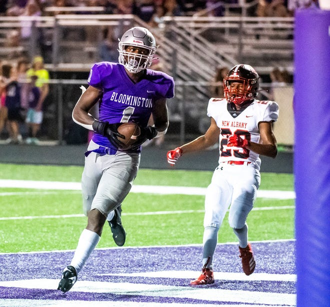 South's Dasan McCullough (1) catches a touchdown pass against New Albany's Amarie DeJesus (23) during the Bloomington South versus New Albany football game at Bloomington High School South Friday, August 20, 2021.