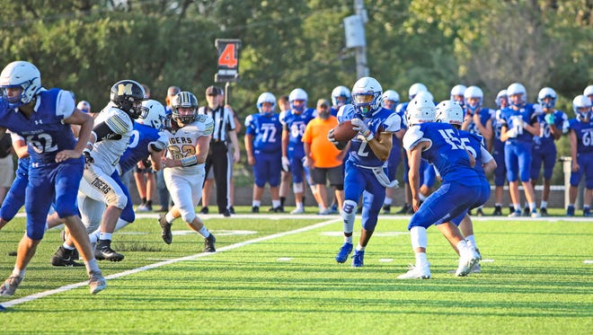 """In a pale preview of their """"Bell Game"""" Linn County rivalry battle at Brookfield's Burlington Field two weeks hence, the 2021 Brookfield and Marceline high school football teams test each other during their head-to-head segment of the Friday, Aug. 20, """"jamboree' scrimmages at Macon."""