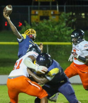 Winter Haven quarterback Joe Tarver attempts a pass against Lake Wales while under heavy pressure.