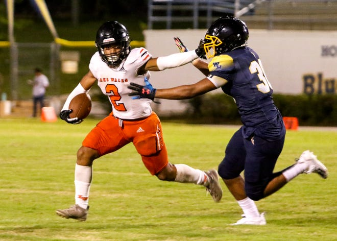 Lake Wales running back Marquish Seabon throws a stiff-arm as he runs for some of his 173 yards against Winter Haven in the Kickoff Class on Friday night at Denison Stadium. Through two regular season games, Seabon has been unstoppable as he has rushed for 476 yards.