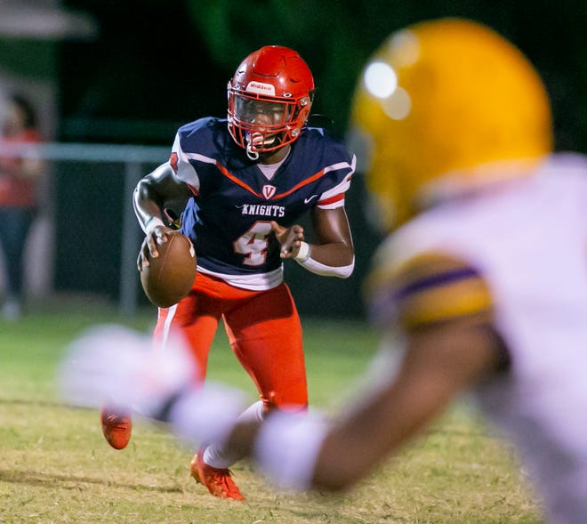 Vanguard's Frederick Gaskin looks for a receiver during Friday's preseason action vs. Columbia High at Booster Stadium.