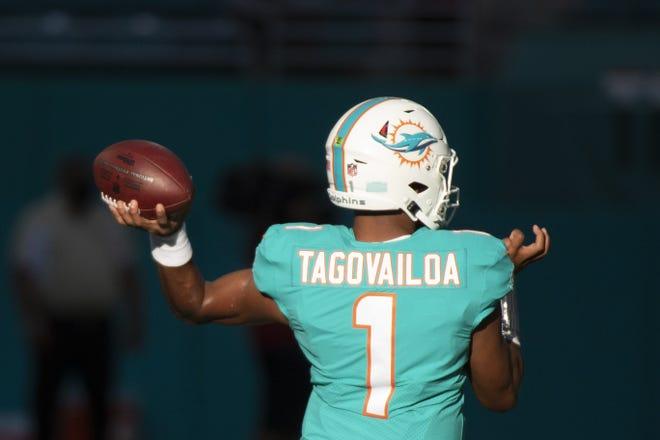 Miami Dolphins quarterback Tua Tagovailoa (1) throws the ball as he warms before the start of a preseason NFL football game between the Atlanta Falcons and the Miami Dolphins, Saturday, Aug. 21, 2021, in Miami Gardens, Fla. (AP Photo/Doug Murray)